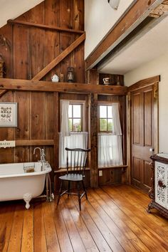 An old dairy barn was converted to make this timber home, including the rustic bathroom. Photo by Bill Matthews.