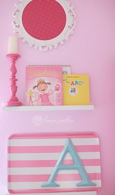 Love this wall display! #pink #baby #nursery