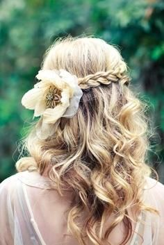 Braided with flower on the side and loose curls