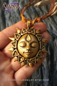 Golden Sun Pendant-summer jewelry protection amulet by ChaNoJaJewelry. tribal necklace. What a warm sunny energy this necklace radiates! The carefully handcrafted sun rays feature lots of tiny details and each of them has a tiny swarovski crystal. She wears a sparkly golden glass drop on her third eye and has a soft smile on her face. Imagine a sunny and hot summer day, and following it a clear night... the crescent moon high in the sky.