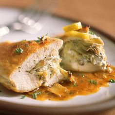 Stuffed chicken breasts with artichoke hearts and goat cheese. Sub ...