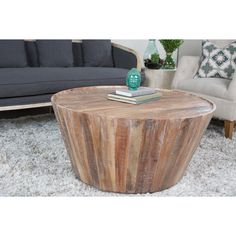 Constructed from distressed acacia wood, the Kosas Home Hamshire Barrel Coffee Table in Lime Wash, is a perfect addition to any decor or home style. The chic design and earthy colors easily pair with a wide assortment of colors.
