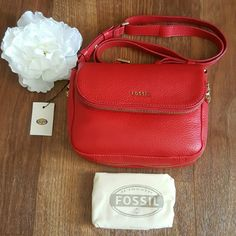 "Fossil Preston Small Flap Real Red Strap Closure: Flap Interior Details: 1 Zipper Pocket Exterior Details: 1 Front Zipper Pocket, 1 Back Zipper Pocket Handles/Straps: 1 Adjustable and Detachable Strap Hardware: Old English Brass Polished Material: 100% Leather Measurements: 8.75""L x 3""W x 6.37""H Strap/Handle Drop Length: 23.5"" Fossil Bags Crossbody Bags"