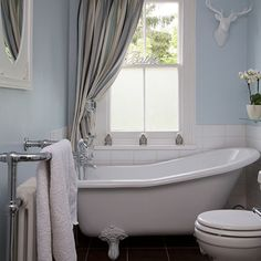 Pale blue bathroom with slipper bath | Bathroom decorating | 25 Beautiful Homes | Housetohome.co.uk