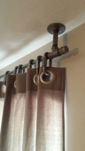 Galvanized plumbing curtain rod hung from ceiling to make ceilings appear taller. Galvanized plumbing curtain rod hung from ceiling to make ceilings appear taller. Diy Curtains, Hanging Curtains, Bedroom Curtains, Shower Curtains, Yellow Curtains, Basement Window Curtains, Basement Window Coverings, Velvet Curtains, Decorative Curtains