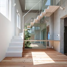 Japanese studio K2YT has slotted courtyard gardens around the staircases and between the rooms of this four-storey house in Tokyo.