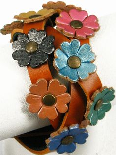 leather flowers on a magic braid? Tandy Leather, Leather Art, Leather Cuffs, Leather Earrings, Leather Tooling, Leather Jewelry, Leather Accessories, Hair Accessories, Leather Flowers