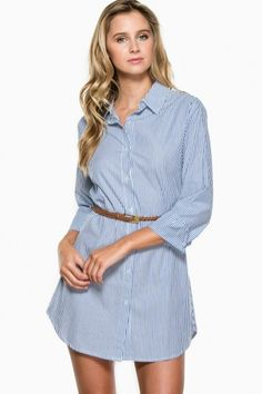 A classic, collared, button down shirt-dress. Belt included.