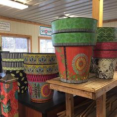 Just a few of the really colorful pots that arrived today!! I love the bright colors against the black & white. -Rachel :) #planters #garden #penfieldny