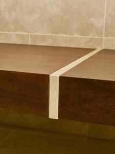 Windsor bathroom 2 - St James Interiors - Walnut bench with marble inlay. Joinery Details, Saint James, Windsor, Saints, Dining Table, Luxury, Bathrooms, Marble, Bench