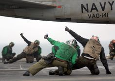 File:US Navy 060204-N-4154B-002 Sailors on the flight deck aboard the Nimitz-class aircraft carrier USS Theodore Roosevelt (CVN 71) signal everything is okay for launch of an EA-6B Prowler from Electronic Attack Squadron One Four O.jpg - Wikimedia Commons