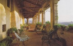 An expansive terrace affording views of the Sabine Hills is furnished with ancient cane furniture in a photo taken by James Mortimer in the ...