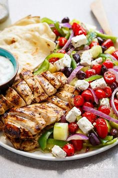 Greek Lemon Garlic Chicken Salad with an incredible dressing that doubles as a marinade! Complete with Tzatziki and homemade flatbreads, it's a winner!   https://cafedelites.com