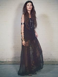 Free People Emma Dress All black outfit with lacy maxi dress, arm cuff, bangles and sandals.
