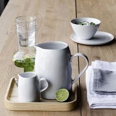 The White Company US. Square Wooden Tray | We absolutely adore our new wooden tray due to its versatility. We love using it as a tray for breakfast in bed and drinks, as well as a scaper for kitchen essentials, such as our Porto Salt Pig and Porto Garlic Keeper. Pinning from the UK? -> http://www.thewhitecompany.com/home/home-accessories/kitchen-accessories/square-wooden-tray/