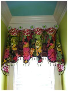 Awesome window treatment.  Metropolis Iron can custom paint any of our drapery medallions to fit in with any of your window treatments.  www.metroiron.net