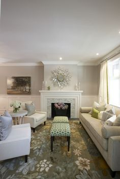 One of my all time FAVORITE living rooms.  Soft and chic with small pops of color!