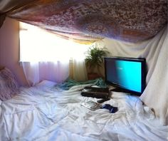 playing video games or watching movies in a blanket fort