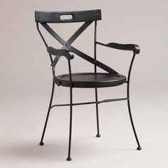 Black Campaign Chair - and it actually looks pretty comfortable, and if not in black, well, spray paint is pretty cheap!