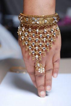 one-ringed hathphool (also called panja) bracelet. Slave Bracelet, Hand Bracelet, Egyptian Jewelry, Indian Jewelry, Kundan Jewellery Set, Silk Bangles, Jewelers Near Me, Hand Jewelry, Personalized Jewelry