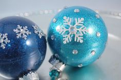 The secret to coating the inside of a clear ornament with glitter? Not glue... use floor cleaner!
