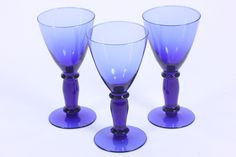 "This listing is for a matching a set of 3 glass 8-ounce water goblets in cobalt blue. They are not marked by the maker. Each stands 7 3/8"" tall with a top opening diameter of 3 3/4"". These stems are p"