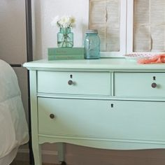 A refinished dresser into a whimsical mint green night stand