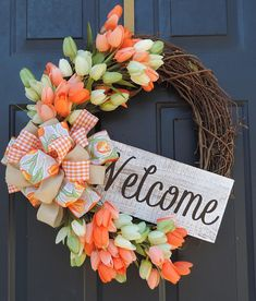 Thanks for stopping by my shop today. This is a beautiful Spring/Summer Grapevine Wreath It has tulips and a large bow added. It is topped off with a nice welcome sign that can be removed. It measures 23 inches. All my wreaths are shipped in a box you can use to store them in.
