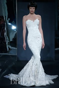 Style 75, strapless silk satin floral embroidered illusion trumpet wedding dress over matte jersey with back flounce, Mark Zunino for Kleinfeld