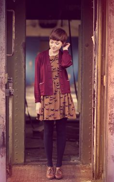 Burgundy cardigan, horse whispering dress, colored tights, and those shoes.