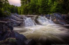 This shows Tobey Falls on Wilson Stream in Willimantic, Maine, part of Piscataquis County.