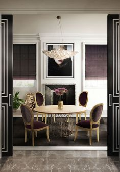 Transitional dining room with glam round dining table and upholstered dining chairs. See more dining room inspirations at:  http://www.brabbu.com/en/inspiration.php