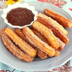 Homemade Churros with chocolate dip. Try this churros recipe for yummy crunchy dough-fried treat with chocolate dip sauce. Filling and so easy to make. Köstliche Desserts, Delicious Desserts, Yummy Food, Cinnamon Desserts, Spanish Desserts, Portuguese Desserts, Food Deserts, Chocolate Dipped, Chocolate Churros