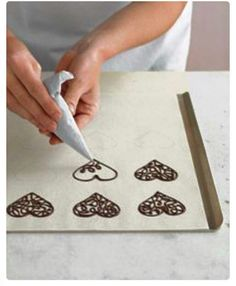 How to make chocolate filigree toppers for cakes, cupcakes, ice-cream, etc. cute idea for lots of things but red angry bird shape for kiddos cupcakes? Cake Decorating Tips, Cookie Decorating, Chocolate Hearts, Chocolate Cupcakes, Chocolate Shapes, Chocolate Designs, Chocolate Toppers, Chocolate Decorations For Cake, Melted Chocolate