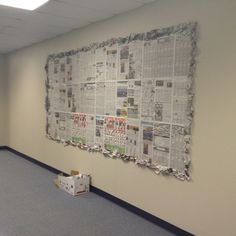 Reuse old newspaper as a bulletin board. Bunch up newspaper as a border. Super easy!