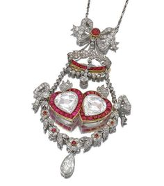 Ruby And Diamond Pendant Necklace Of Bow And Heart Design, Millegrain Set With Rose, Single-Cut And Pear-Shaped Diamonds, Cabochon, Calibre And Circular-Cut Rubies, Embellished With A Paired Heart Motif Set With Rose-Cut Pear Shaped Diamonds And Rubies    c.1910   -  Sotheby's 1910 Sotheby's