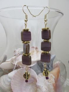 A personal favorite from my Etsy shop https://www.etsy.com/listing/268160243/dangle-earrings-with-square-purple-glass