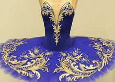 Blue tutu with stunning gold filigree plate www.theworlddances.com/ #costumes #tutu #dance