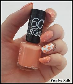 And that's how we created this flower & dots nail look! It's a gorgeous look for your nails this spring! Perfect for everyday wear!