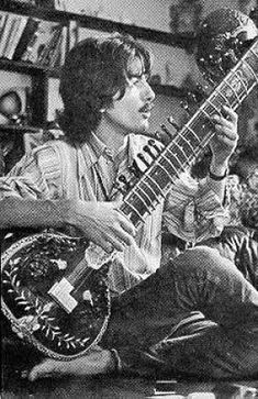 George Harrison playing the sitar