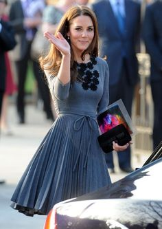 Kate Middleton. Lovely dress! Pretty blue, pleats and the black rosette detailing is adorable.