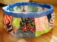 Charmed Fabric Bowl - Fans of nine patch quilt patterns will enjoy taking a break from their large patterns and making a cheery 36 patch variation with charm pack quilt patterns.