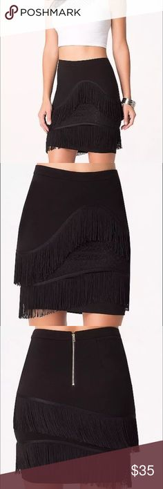 """Bebe fringe detail skirt size L New.  Color: black Size: large Tantalizing ponte jersey skirt detailed with double tiers of super-flirty asymmetric fringe framing a peekabo lace panel. Back hook-and-eye and exposed goldtone zip closure. Fully lined. 63% Rayon, 32% nylon, 5% spandex Hand wash Imported Center back to hem: 19"""" (48.5 cm) bebe Skirts Mini"""