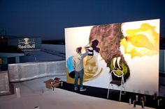 An artist on the rooftop at Hotel Erwin works his magic.