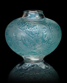 René Lalique 'Aras' a Vase, design 1924 frosted glass, heightened with blue staining 22.5cm high