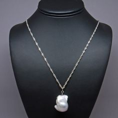 14k Solid White Gold Claw Bail Holds a Black-blue AAA Cultured Pearl Pendant TPJ