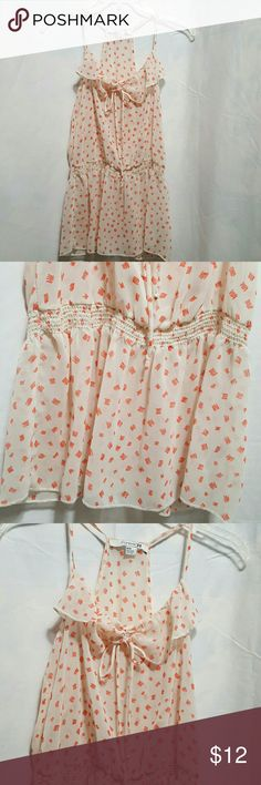 """👄NWOT Forever 21 blouse Creme & peach, elastic waist, tie in the front, spaghetti straps.  Fabric is sheer, 100%polyester, hand wash.   Length 28"""" armpit to armpit 17""""  🚭Smoke-free home Forever 21 Tops Blouses"""