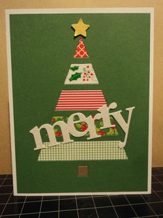 handmade Christmas card from Card Corner by Candee ... washi tapes for die cut triangle tree ... since the green base card would show through, the washi was adhered to white card stock ... die cut MERRY on top ... neat a graphic look ...