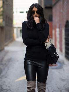 These pale over the knee boots make the perfect contrast to Kayla Seah's otherwise all-black outfit. Try wearing pale boots in varying shades to get a similar look. Boots: Stuart Wetizman, Leggings: Drome, Top: Club Monaco, Bag: Gucci.