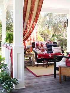 Layered in red, white, and blue, any outdoor space becomes patriotic. Set the scene by hanging a flag (hang the union—blue field—at the top left as it is viewed from the street or yard). Striped fabric, gathered and tied to the porch railing with heavy blue yarn, recalls classic bunting.